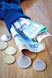 在一只老袜子的储款 免版税库存图片