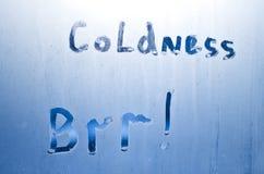 在一块冻玻璃书面寒冷brr 免版税库存图片