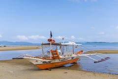 在一块干陆的渔船 免版税图库摄影
