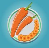 在一块板材的红萝卜有切片的 免版税库存图片