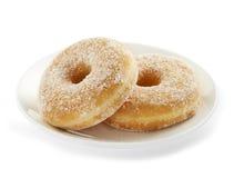 在一块白色板材服务的两个鲜美油炸圈饼 免版税库存照片