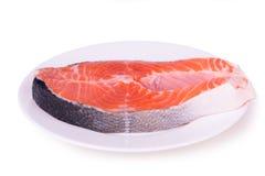 在一块白色板材的三文鱼 免版税图库摄影