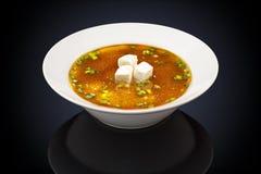 在一块白色板材的大酱汤 图库摄影