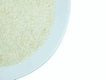 在一块白色板材的米在白色背景孤立 图库摄影