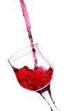 在一块红葡萄酒玻璃的飞溅 免版税图库摄影
