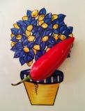 在一块陶瓷板材的炽热辣椒有蓝色和黄色装饰的 免版税库存照片