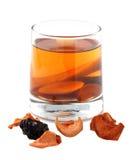 在一块玻璃的被分类的干果蜜饯在白色背景 免版税库存照片