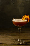 在一块玻璃的酒与柑橘 免版税库存图片