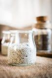 在一块玻璃的酸奶和chia种子在桌上 免版税库存照片