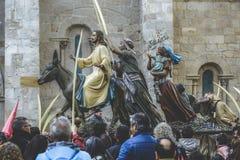 在一头驴的耶稣基督骑马棕枝全日复活节星期 特点复活节,圣周在西班牙 圣周在萨莫拉,西班牙 免版税图库摄影