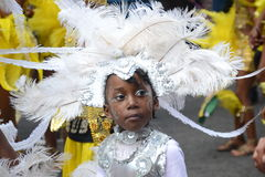 在一套服装的逗人喜爱的孩子在Notting Hill狂欢节 库存图片