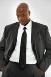 在一套现代西装的可爱的黑色男 库存图片