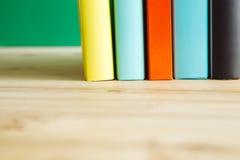 在一张木书桌上的书 免版税库存图片