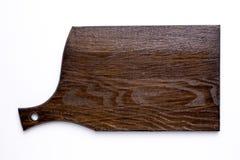在一张白色背景顶视图的木厨房板 免版税库存图片