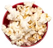 在一张红色碗顶视图的玉米花 免版税图库摄影