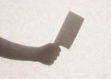 在一张透明纸后的剪影 库存图片