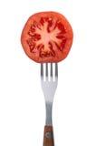 在叉子的蕃茄 库存图片
