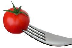 在一把叉子的蕃茄在白色 免版税库存图片