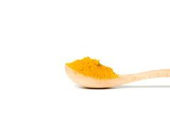 在一把木匙子的姜黄粉末 库存图片
