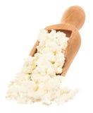 在一把木匙子的酸奶干酪 库存照片
