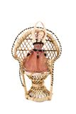 在一把藤椅的芭蕾舞女演员玩偶 免版税库存照片