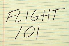在一本黄色便笺簿的航班101 免版税库存图片