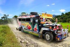 在一条农村路的Jeepney。 免版税库存照片