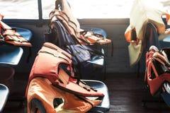 在一条小船的救生衣在远航期间的安全的 免版税图库摄影
