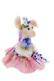 在一条桃红色裙子的白色玩具猪 图库摄影