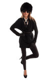 在一条腿的女性式样身分 免版税图库摄影