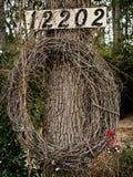 在一棵树的藤花圈与数字 免版税库存图片