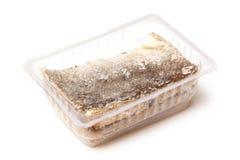 在一次性容器的盐渍鳕鱼片断 库存图片