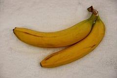 在一灰色袋装的两个香蕉 免版税库存图片