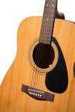 在一白色backgroun隔绝的古典声学吉他关闭 免版税图库摄影
