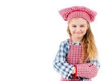 在一白色backgroung隔绝的一个小厨师女孩的画象 免版税图库摄影