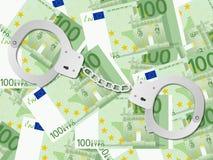 在一百欧元背景的手铐 库存图片