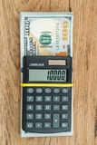 在一盒的计算器美元 免版税库存照片