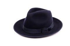 在一种深蓝颜色的一个经典低冠浅顶软呢帽帽子 库存图片