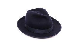 在一种深蓝颜色的一个经典低冠浅顶软呢帽帽子 图库摄影