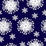 在一种深蓝颜色的白色雪花 皇族释放例证