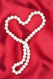 在一种红色织品的符号心脏 图库摄影