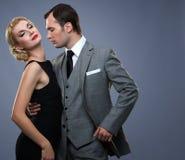 在一起经典服装的夫妇 免版税库存照片