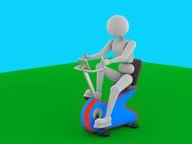 在一辆固定式自行车的被加强的训练 免版税图库摄影