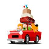 在一辆红色汽车的家庭 免版税库存照片