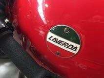 在一辆红色葡萄酒摩托车的Laverda象征 免版税图库摄影