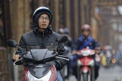 在一辆自行车上在河内 免版税图库摄影