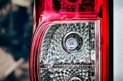 在一辆车的左尾灯有高强度LED电灯泡的替换 免版税库存图片