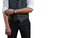 在一件白色衬衣的一个年轻商人卷起prepar他的袖子 库存照片