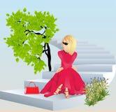 在一件红色礼服 免版税库存图片