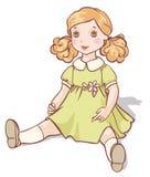 在一件绿色礼服的动画片玩偶 库存图片